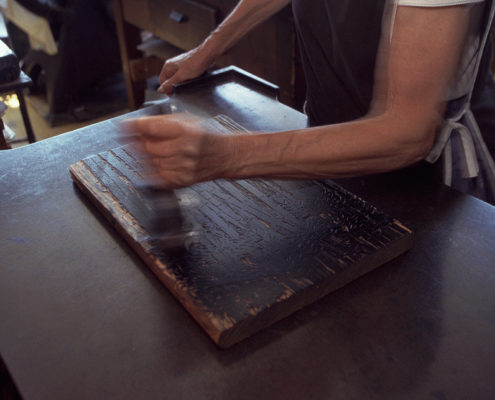 inking the block hand press